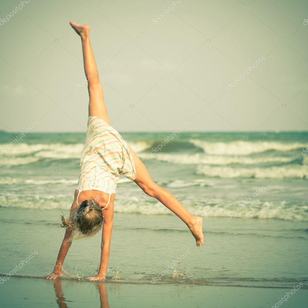 Beautiful girl having fun at beach