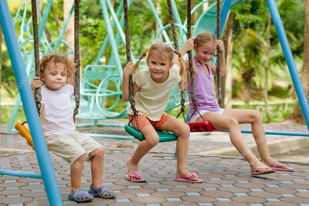 Happy little girls and boy on a swing — Stock Photo © altanaka ...