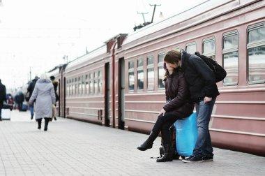 Couple on railway station platform