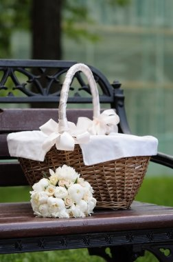 Picnic basket and flowers bouquet