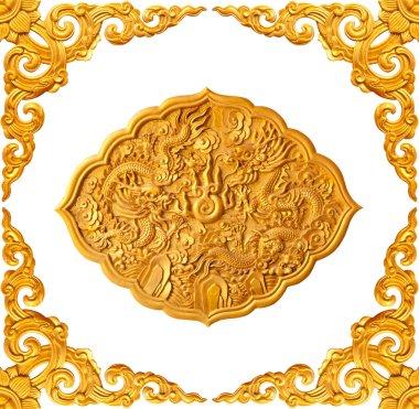 golden frame and dragon carve