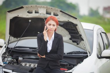Woman with car broke down