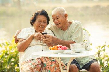 Senior couple using the mobile phone