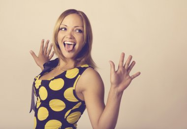 Young woman making a funny face toned in warm