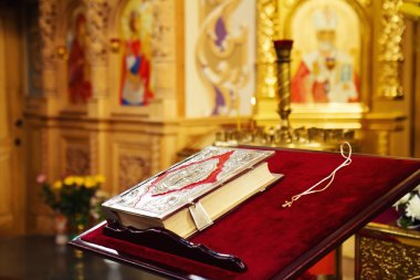Holy Bible and Orthodox cross in orthodox church