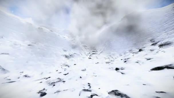 lezení zasněžené hory