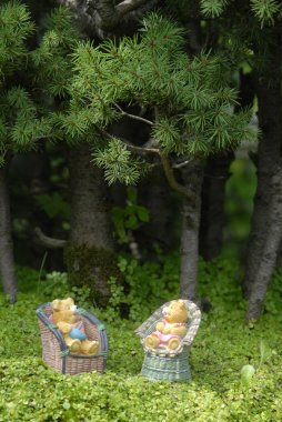Baby teddy bears sitting in the forest