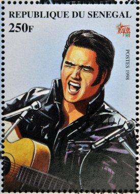SENEGAL - CIRCA 1998: A stamp printed in Senegal shows the famous Elvis Presley, circa 1998