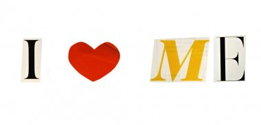 I Love me formed with magazine letters on a white background