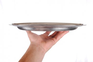 Hand holds a serving tray, isolated on white