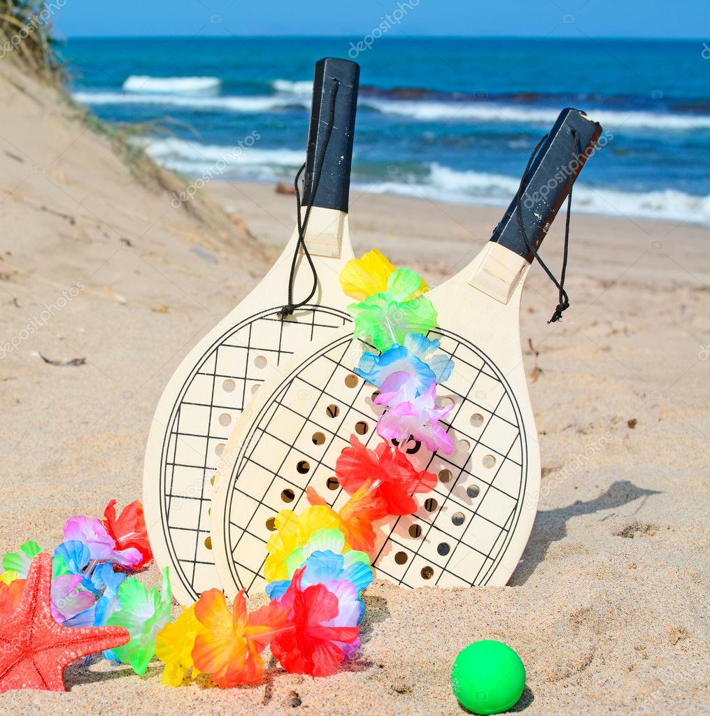 rackets and necklace by the dune