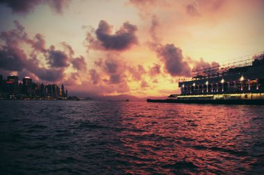 Sunset in Hong Kong: view of Victoria Harbour from Kowloon Island. Some vintage, retro toning added