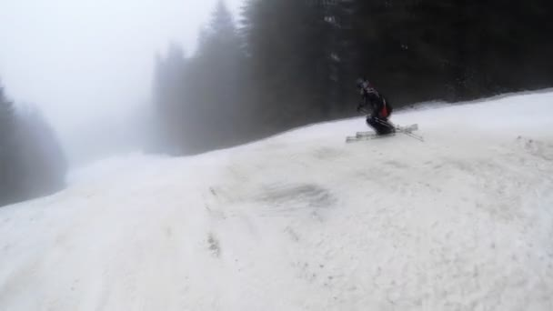 Motion camera view of skier is riding in the mountains