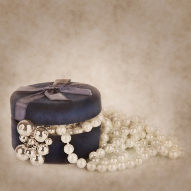Pearl beads in the slightly opened casket. Vintage