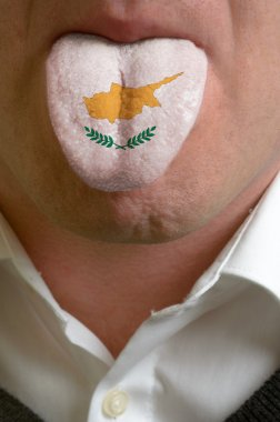 man tongue painted in cyprus flag symbolizing to knowledge to sp