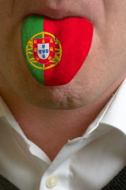 man tongue painted in portugal flag symbolizing to knowledge to