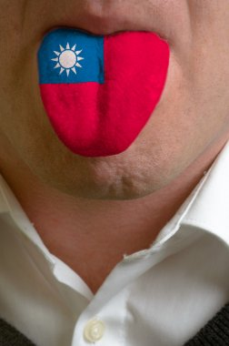 man tongue painted in taiwan flag symbolizing to knowledge to sp