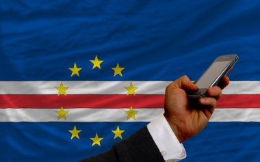cell phone in front national flag of of capeverde