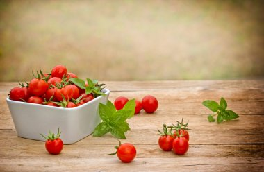 Cherry tomato in bowl on the table