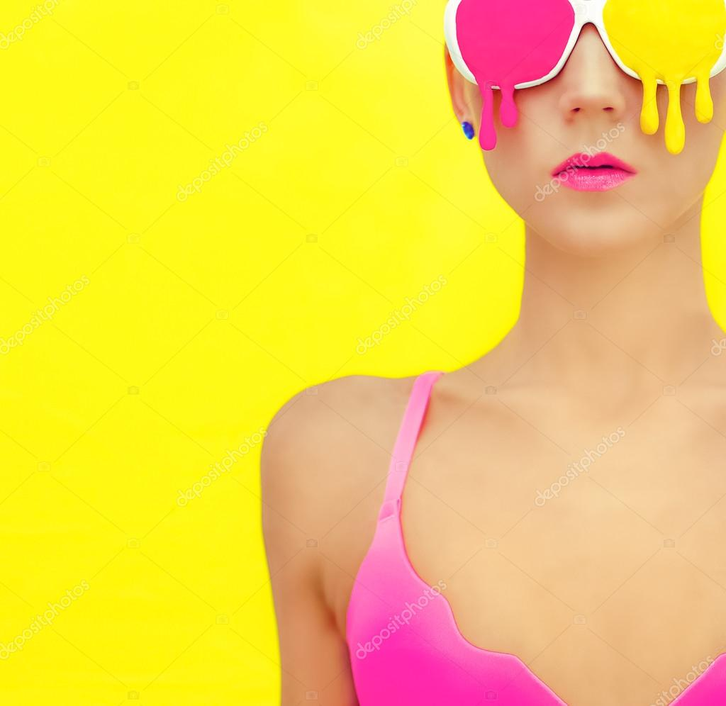 bright girl in exclusive colorful glasses