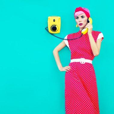 Retro fashion girl talking on a vintage telephone