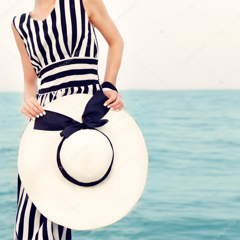 fashion portrait of a girl on a beach holiday