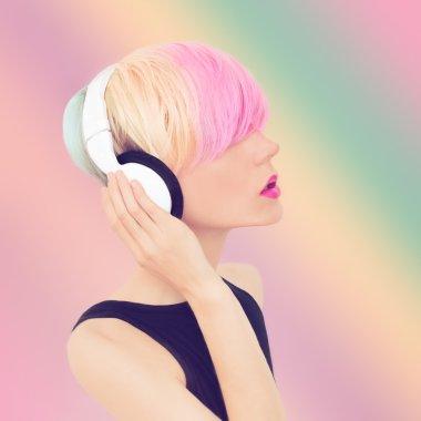 Sensual girl in stylish headphones