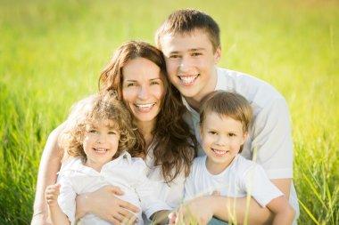 Happy family in spring field