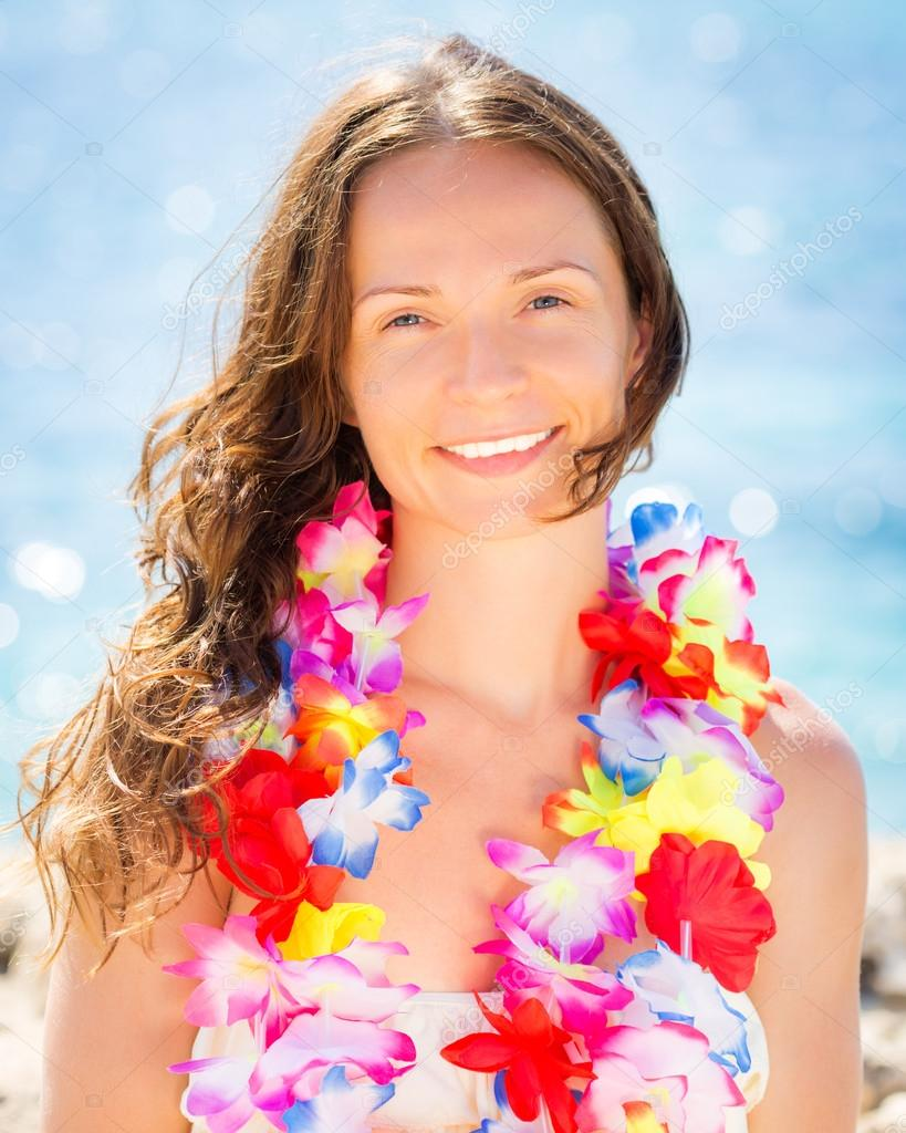 Woman with hawaiian flowers garland stock photo yaruta 24527727 woman with hawaiian flowers garland stock photo izmirmasajfo