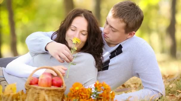 Happy couple relaxing in autumn park