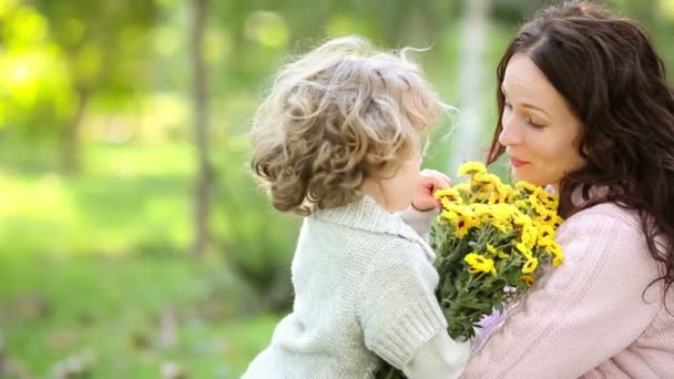 Mother, girl and yellow flowers