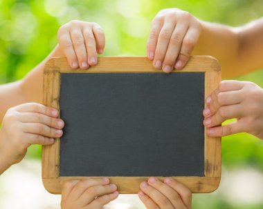 Blackboard blank in hands