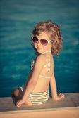 Fotografie Sunscreen lotion drawing sun