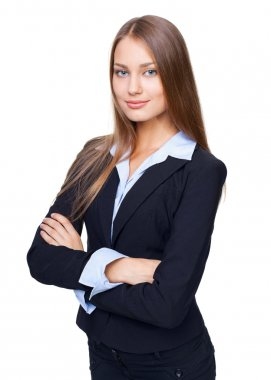 Portrait of young smiling businesswoman standing with hands fold