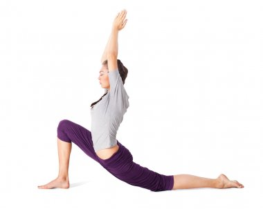 Young woman doing yoga asana low lunge