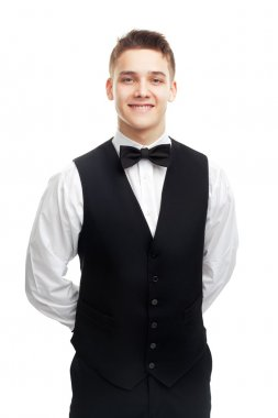 young smiling waiter isolated on white background