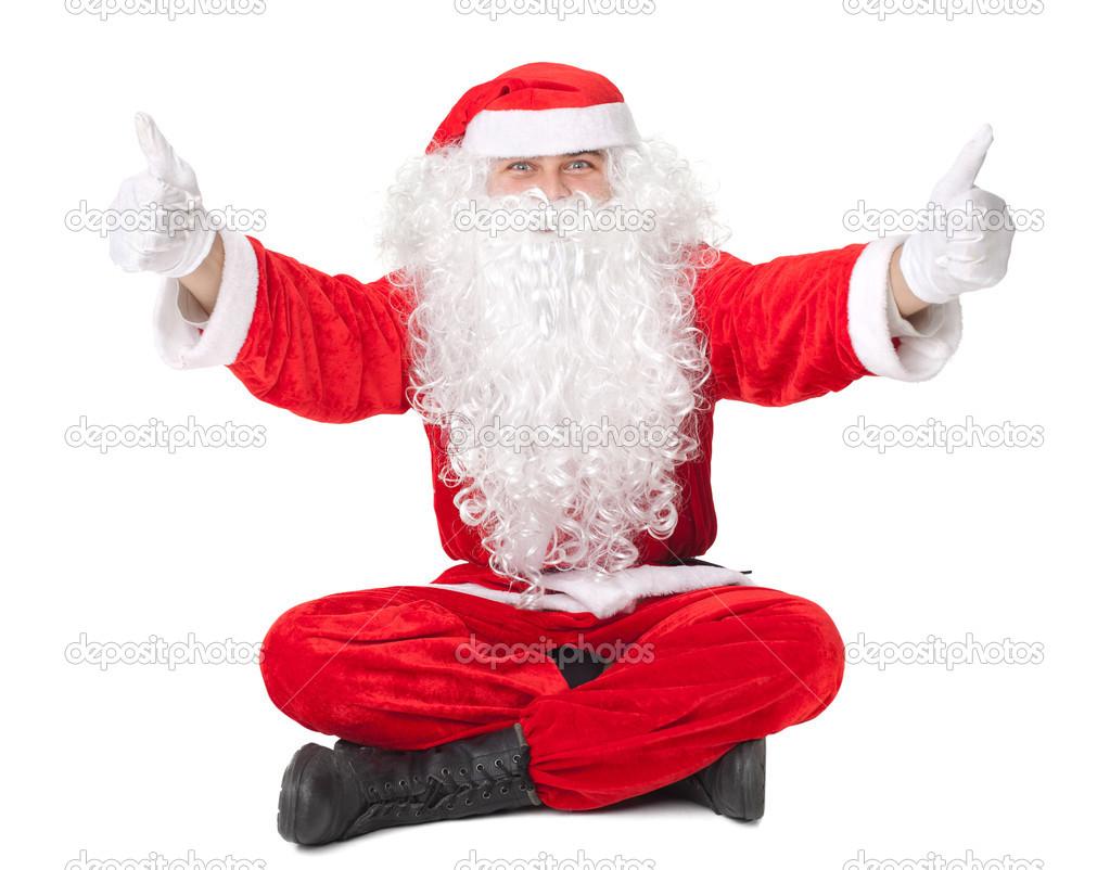 pere noel assis Père Noël assis sur le plancher avec le pouce vers le haut de  pere noel assis
