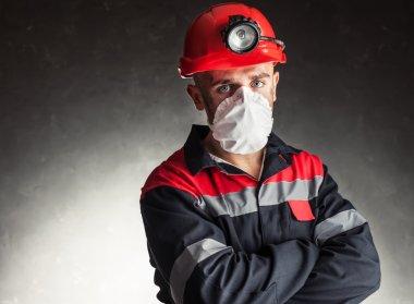 Coal miner with respirator