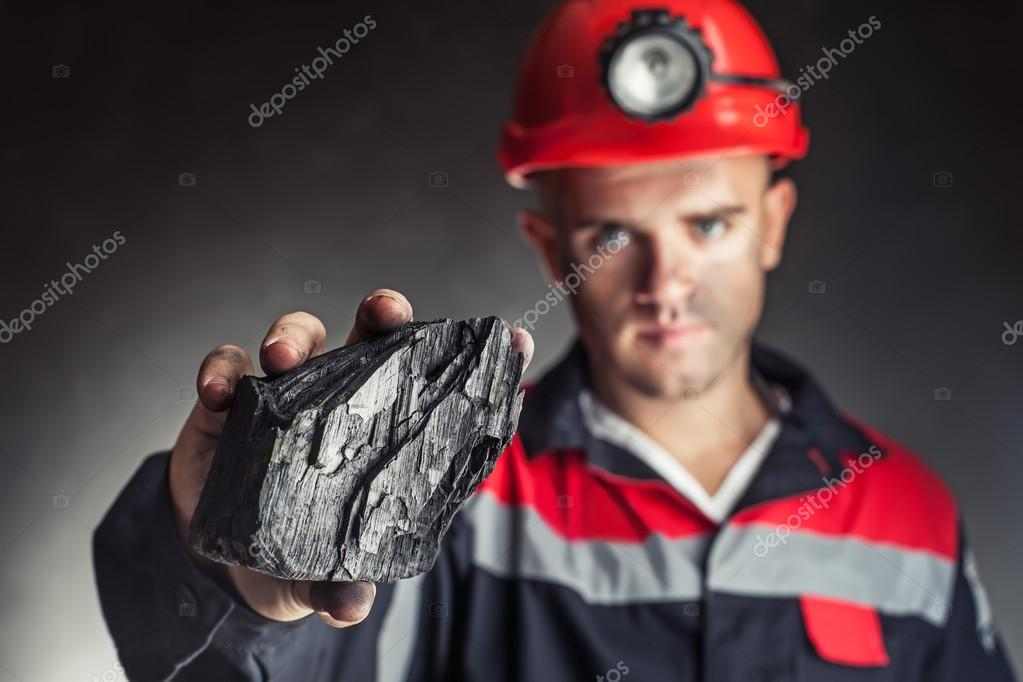 Coal miner showing lump of coal