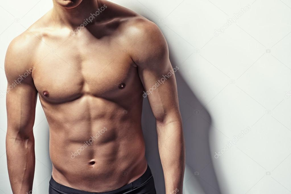 Muscular Torso Of Young Man Stock Photo Gladkov 45562521