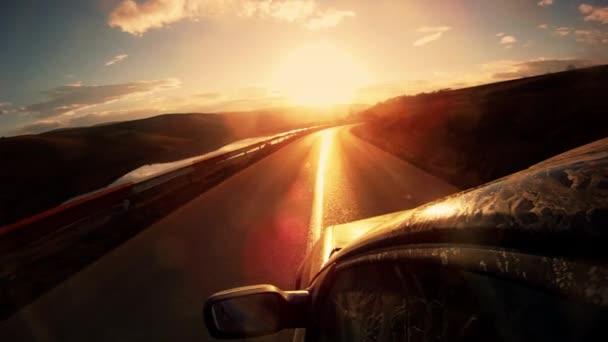 řízení při západu slunce