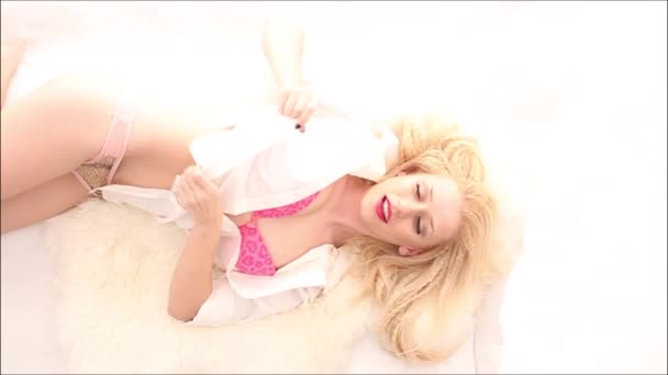 Gorgeous blonde in white bed, seen from above