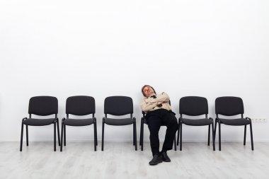 Tired businessman waiting