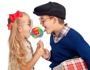 Kids sharing a large lollipop