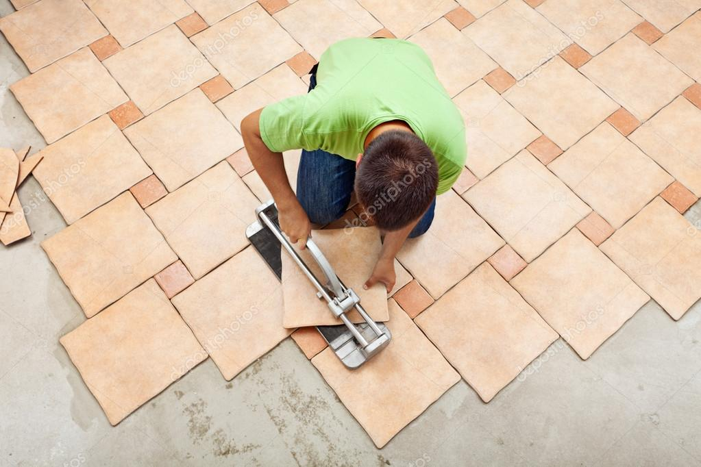 Man Laying Ceramic Floor Tiles Stock Photo Lightkeeper 31417861