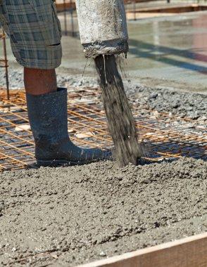Pouring concrete at a construction site - closeup