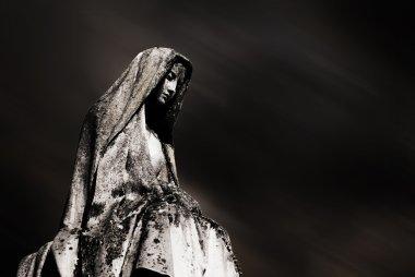 Virgin mary and dark sky