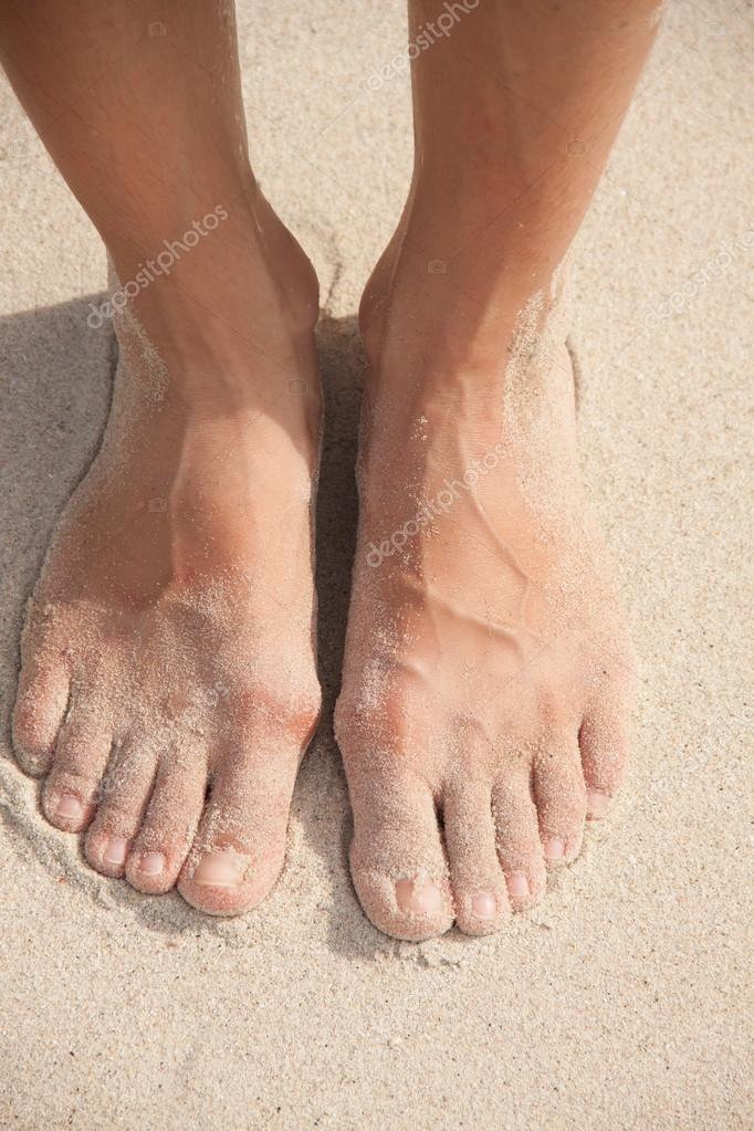 womens feet in the sand