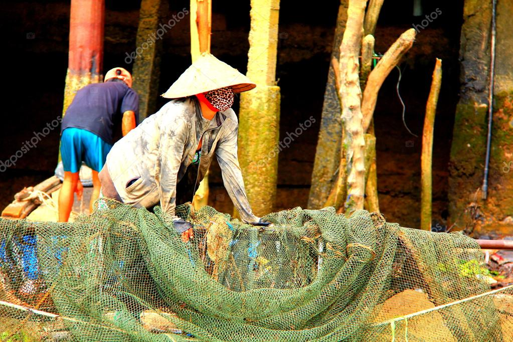 Woman fishing in Vietnam in the Mekong Delta