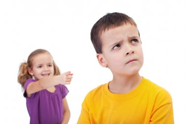 Bullying concept - girl mocking young boy